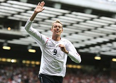 Peter Crouch waves to the crowd