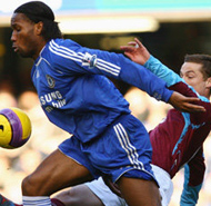 Chelsea's Didier Drogba fights for the ball with Scott Parker of West Ham.