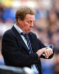 Harry Redknapp, yawning at danger, checks his watch.
