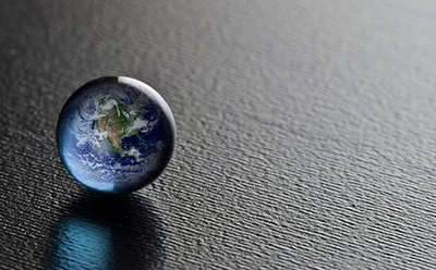 The Earth as a marble on a table.
