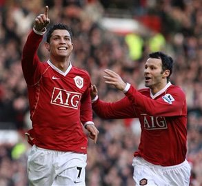 Cristiano Ronaldo celebrates with Ryan Giggs.