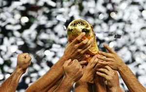 The World Cup trophy in a blizzard of confetti.
