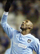 Anelka points to the sky.