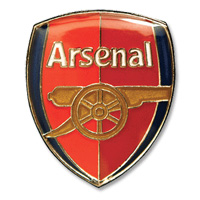 A gleaming Arsenal pin.