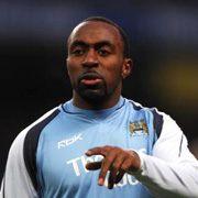 Vassell gestures calmly for Man City.