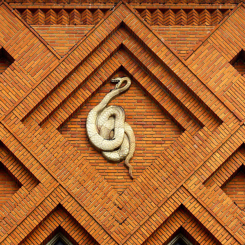 A majestic serpent in baroque brickwork.