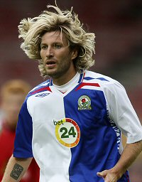 Robbie Savage's mane in full bloom.