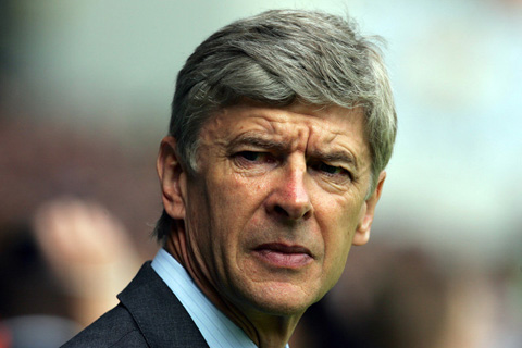 Arsene Wenger, looking worried.