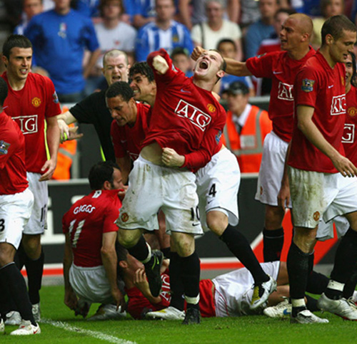 Wayne Rooney roars his defiance to the heavens as Ryan Giggs goes down.
