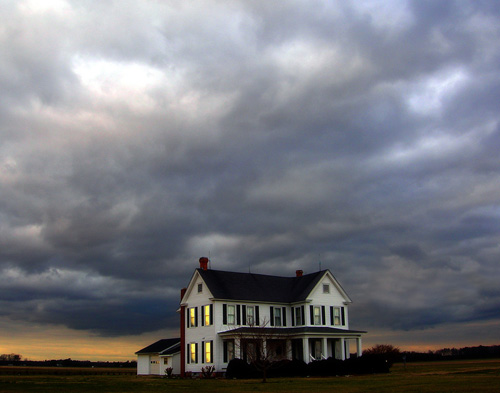 Stormclouds over an isolated house.