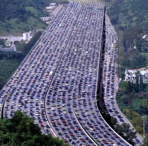 A highway clogged with cars.
