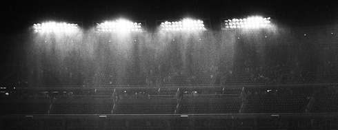 Rainy night under the stadium lights