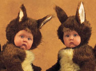 Babies in squirrel costumes