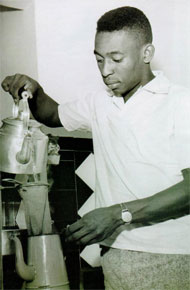 Pele making coffee