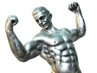 A muscular statue, grinning